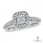 Princess cut diamond surrounded with pave set diamonds.