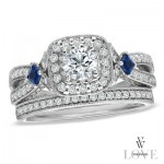 Brilliant cut diamond with channel set diamond split shank and two kite set sapphires.
