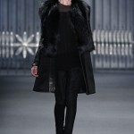 Be warm and stylish as you party hop in this suede fox-detailed coat from the Vera Wang Fall 2011 collection.