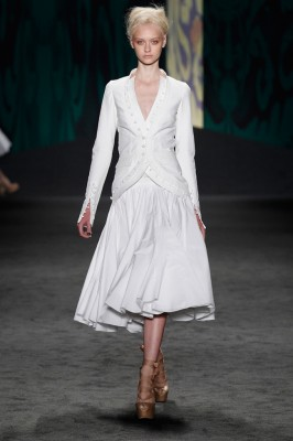 Look 1: White cotton canvas sleeveless cut away jacket over white cotton voile sleeveless wrap dress with dancing skirt and soutache embroidered bodice | Photography: Dan Lecca