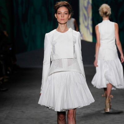 Look 3: White cotton canvas soutache embroidered sleeveless high-low top over white cotton canvas Bermuda with soutache tuxedo stripe | Photography: Dan Lecca