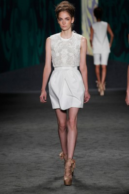 Look 6: White cotton canvas cropped sleeveless choli jacket with soutache embroidery over white cotton canvas sleeveless corseted dress with tulip skirt | Photography: Dan Lecca
