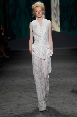 Look 8: White lace jacquard sleeveless cut away jacket with white cotton eyelet sleeveless scarf top with back vent detail over white lace jacquard long pajama trouser | Photography: Dan Lecca